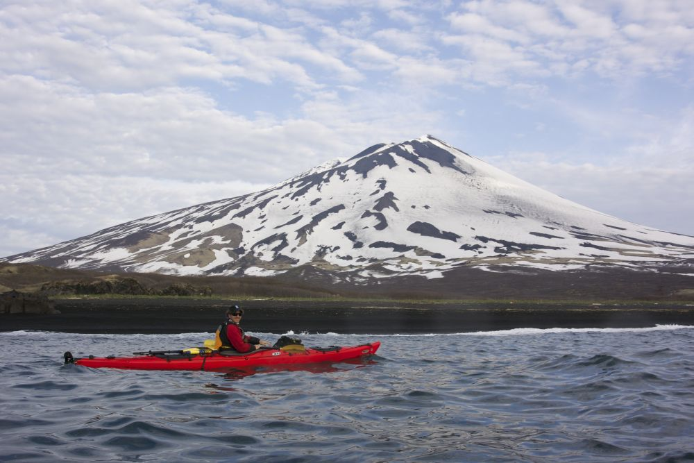 © XNelson Expeditioners onboard Heritage Expeditions Russia's Ring of Fire explore the land of fire and ice by sea kayak